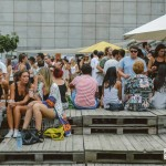 Crowd relaxing during the summer's heat.