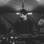 DJ performing inside marquee.